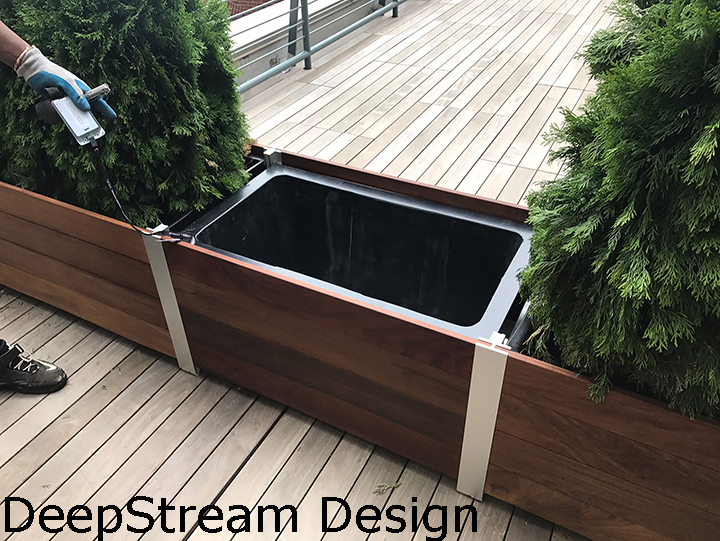 Close up of multi-section planters that has been reconfigured to fit a smaller space